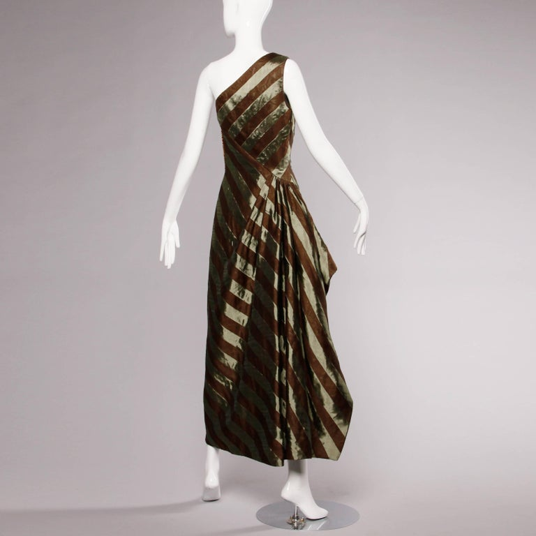 Stunning 1999 Michael Casey Couture sage green and brown silk one shoulder evening gown. Dramatic couture draping and asymmetric cut. Fully lined in silk. Side zip and hook closure. The dress is a marked size 8, but fits like a modern size small.