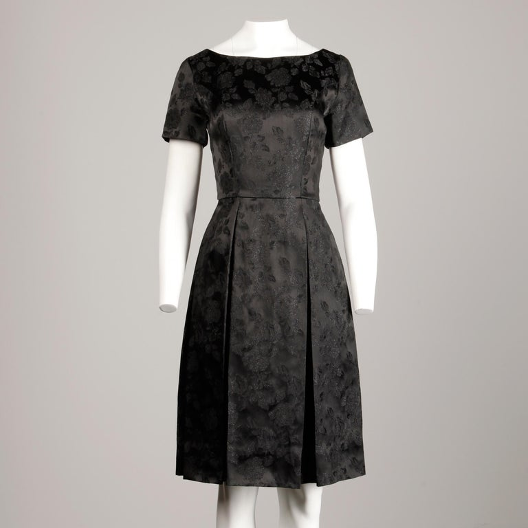 Women's 1960s Vintage Black Satin Floral Brocade Cocktail Dress with Box Pleats For Sale