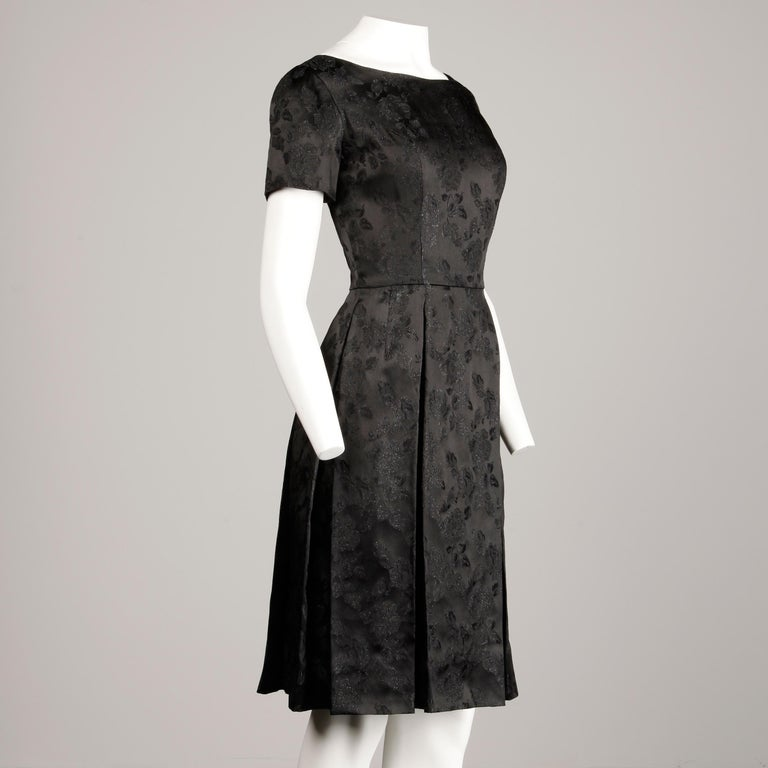 1960s Vintage Black Satin Floral Brocade Cocktail Dress with Box Pleats For Sale 2