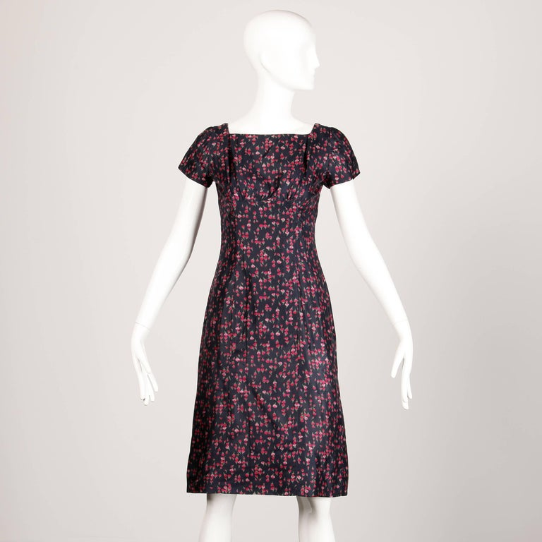 Darling two piece silk floral print sheath dress and matching coat set. Estimated size XS-S.   Details: Coat  Fully Lined Side Pockets Marked Size: Not Marked Color: Blue with Pink Flowers Fabric: Silk Label: Not Marked  Measurements:   Bust: