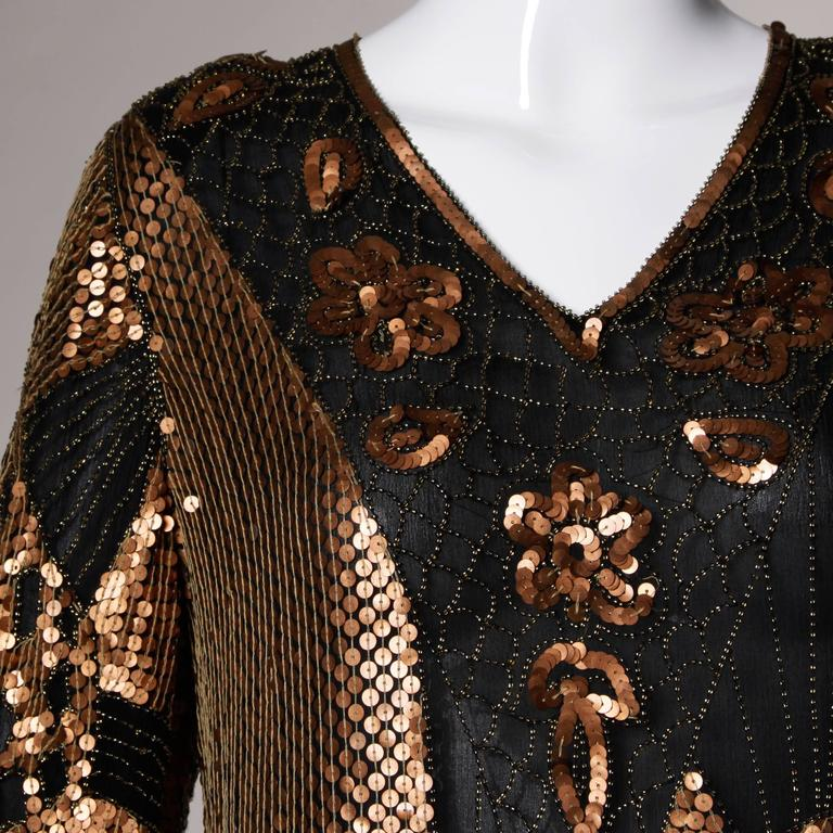 Metallic sequin and beaded flapper-inspired vintage dress with the original tags attached in unworn vintage condition. High side slits and jagged scalloped hem.  Details:  Fully Lined Shoulder Pads Can Be Easily Removed If Desired No