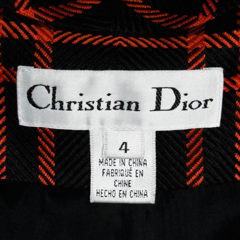 Chic orange and black plaid blazer jacket by Christian Dior.  Details:  Fully Lined Front Button Closure Marked Size: 4 Estimated Size: Small Color: Orange/ Black Fabric: 100% Silk/ 100% Acetate Label: Christian