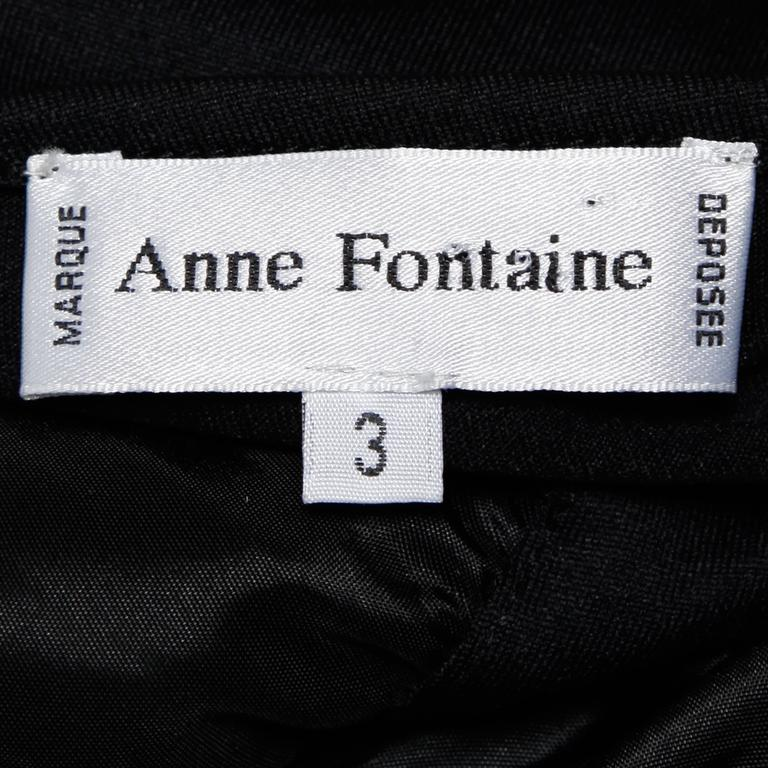 Elegant contemporary black jersey knit top with ruching. By French designer Anne Fontaine.  Details:  Unlined No Closure/ Fabric Contains Stretch Marked Size: 3 Estimated Size: Medium Color: Black Fabric: 100% Polyester/ 8% Elastic/ 92%