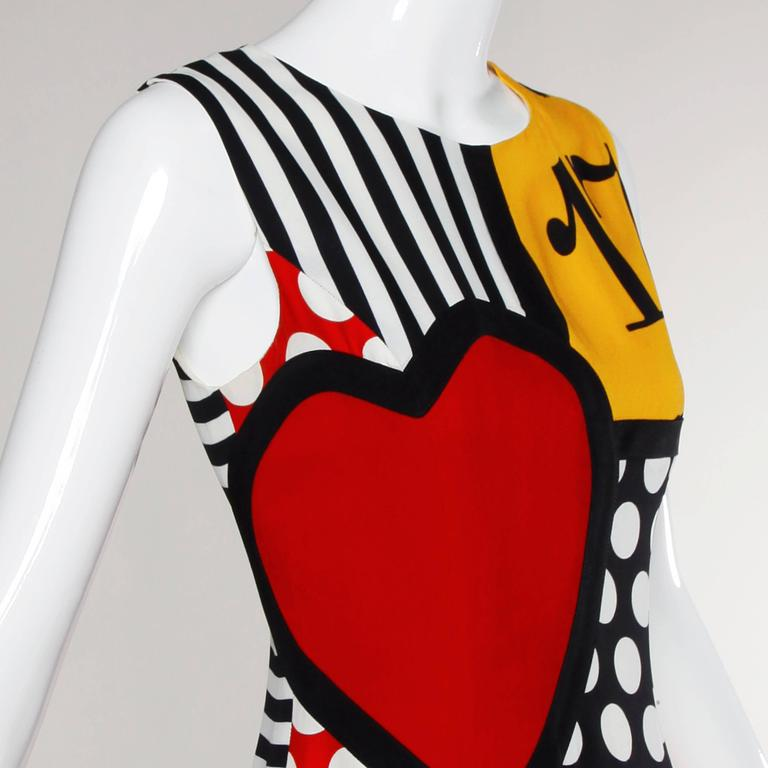 Reduced from $950! Iconic vintage Moschino dress with a vibrant pop art design which features numbers, polka dots, stripes, a heart, black cats and horseshoe design.   Details:  Fully Lined Back Zip Closure Marked Size: I 42/ US 8/ D 38/ F 38/