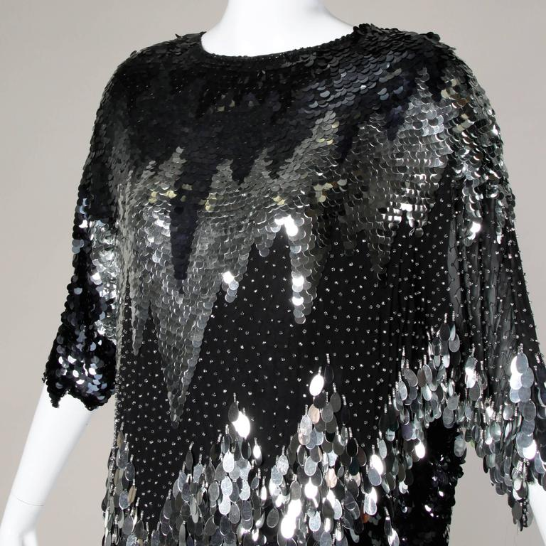 Flashy vintage flapper-inspired cocktail dress from the 1980s in beaded and sequin-encrusted black silk. Zig Zag design and asymmetric hemline.
