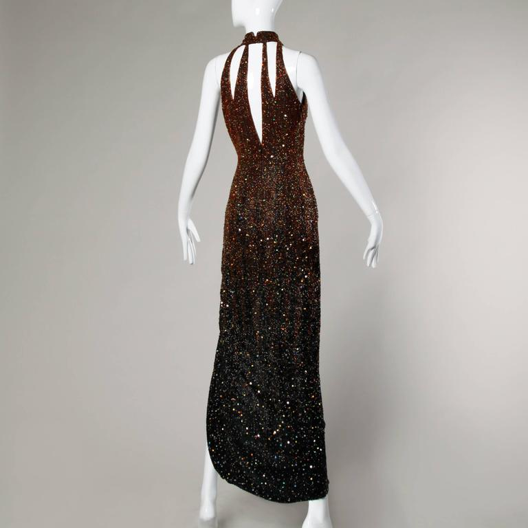 Incredible heavily beaded silk gown in with ombre sequin and beadwork that gets darker towards the bottom of the dress. Cut out detail and side slit.