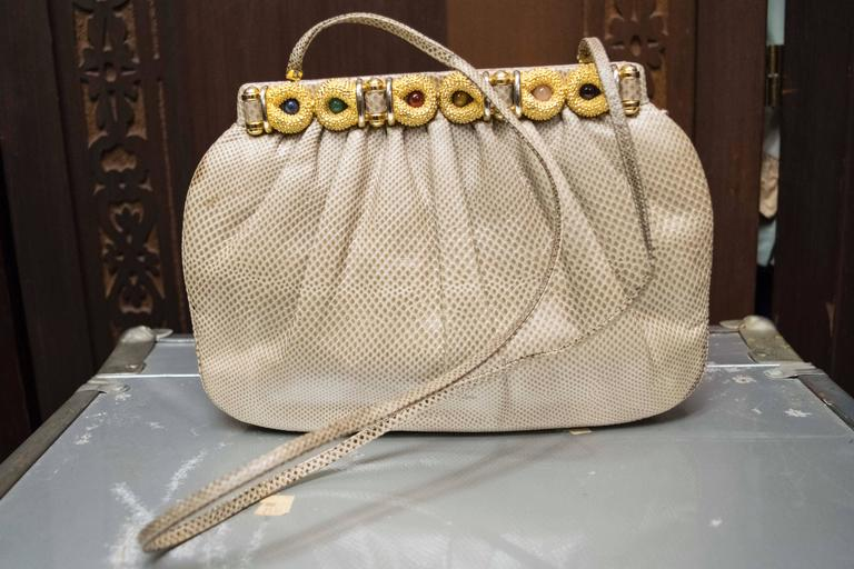 1980s Judith Lieber Snakeskin Handbag  Wonderful snakeskin skin handbag designed by Judith Lieber circa 1980, with fabulous gem encrusted detail. Lined with suede.   L 10 H 6.5 D 2