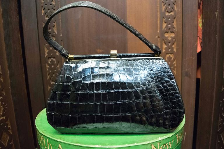 1950s Bellestones Black Alligator Handbag  This bag is lined in red leather and comes with original compact and coin purse.  L 10.5 H 6.5 D 3.5