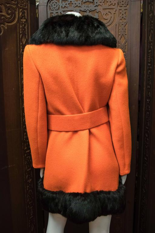1960s Lilli Ann Red Rabbit Trimmed Coat   Wonderful coat designed by San Francisco designer Lilli Ann, very Jacky O. There is slight wear on the fur on the lapel, aside from that it is in excellent condition.    B 36 W 30 H 40 L 36