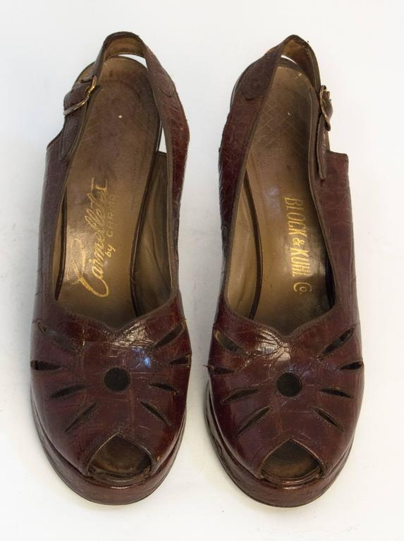 40s peep toe platforms. Cutouts on toe tops. Leather soles.   Measurements Insole: 9 1/2