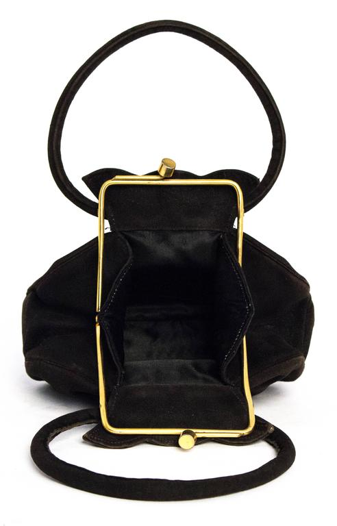 40s Black Suede Petite Handbag. Gold tone hardware. Satin lining with two small compartments.