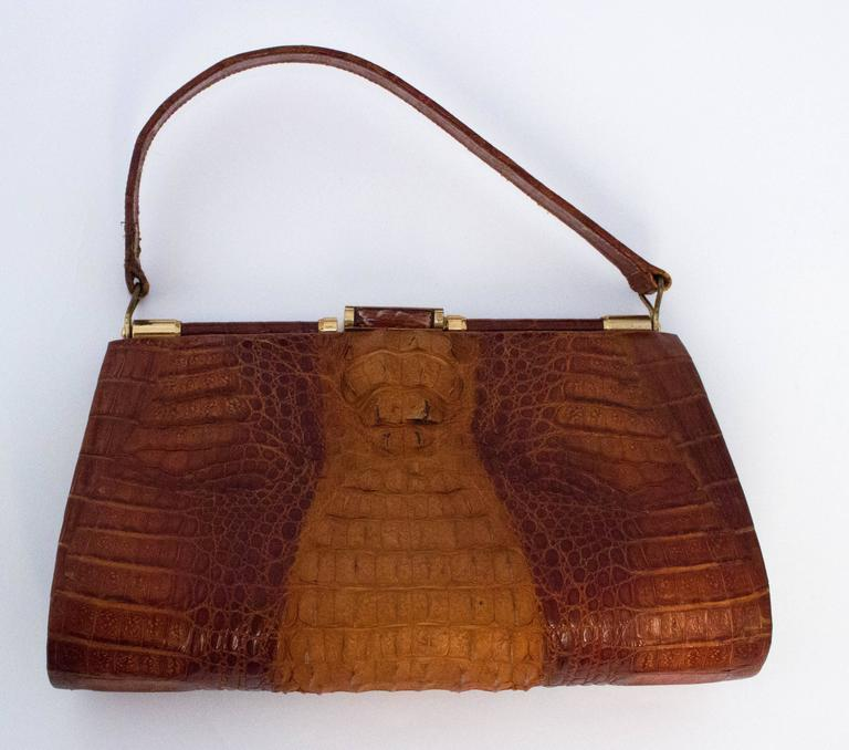 9378d3677545 50s Hornback Alligator Handbag. Gold toned hardware. Three interior  compartments