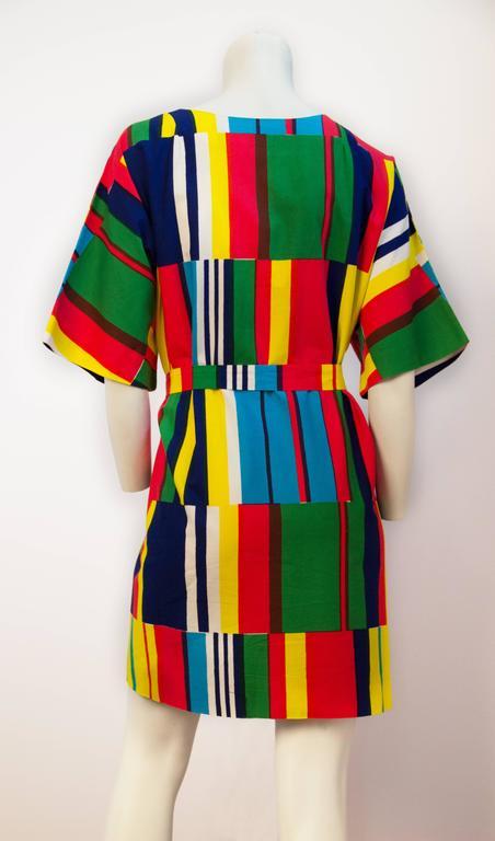 70s Marimekko printed dress. Inset side pockets. Zips up the front. Original sash.
