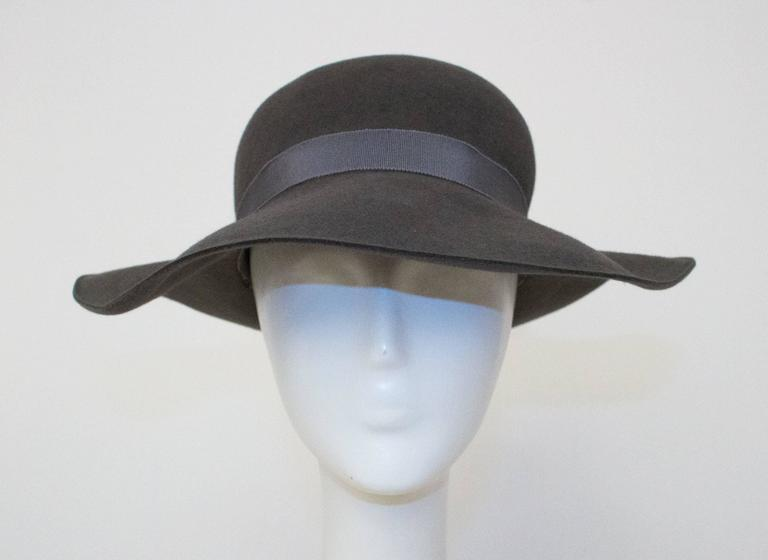 """80s Giorgio Armani felt floppy hat. Extremely soft. Gros grain interior and exterior band.   Measurements  21 1/2"""" circumference  2 3/4"""" - 3 1/2"""" wide band"""