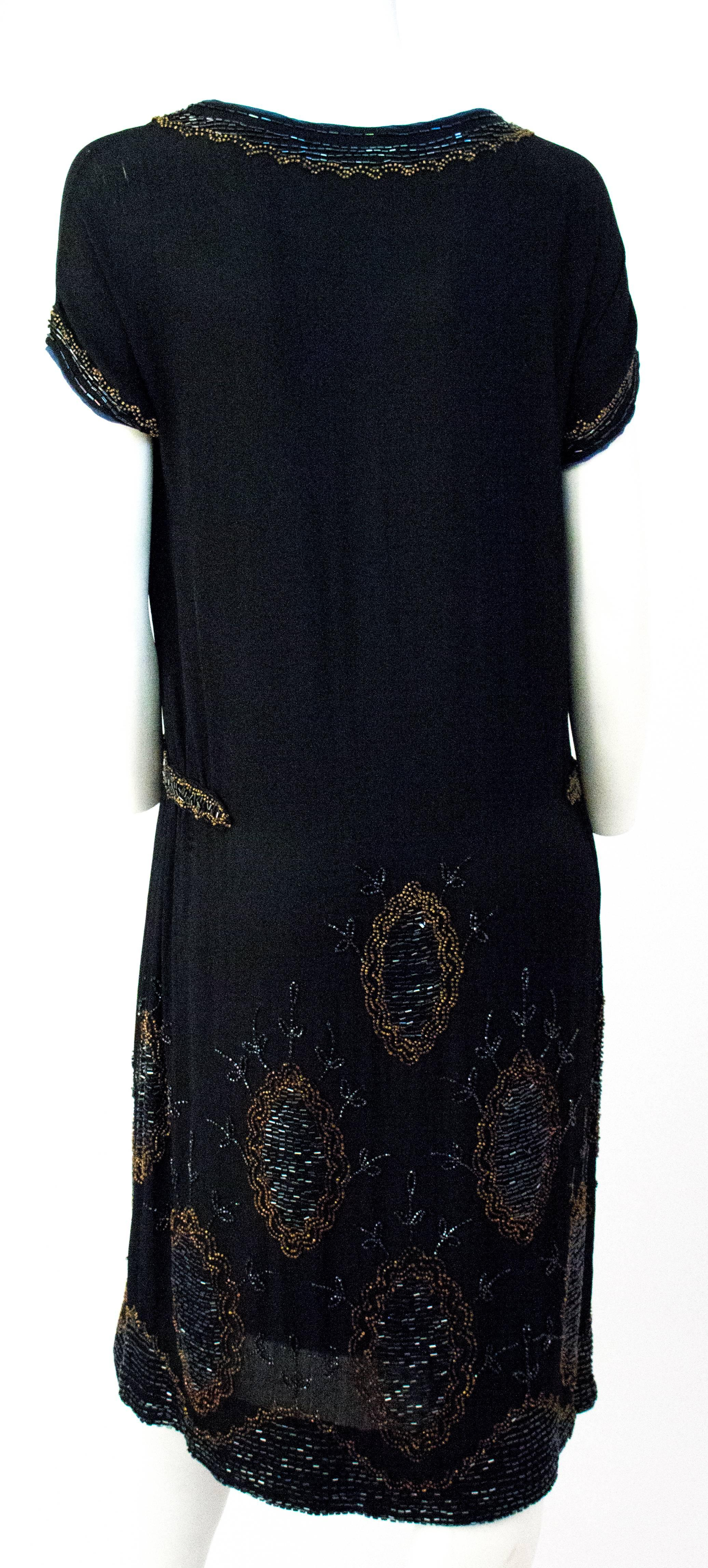 381017dc4c 20s Black Silk Drop Waist Dress with Gold and Green Beading For Sale at  1stdibs