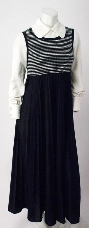 70s Classic Black and White Apron Dress with bishop sleeves, puritan collar, and empire waist.