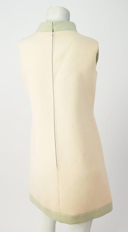 60s Carven Boutique Cream & Mint Mock Turtle Neck Dress. Medium weight wool blend fabric. Fully Lined. Metal zipper up the back with hook and eye closures at the neck.