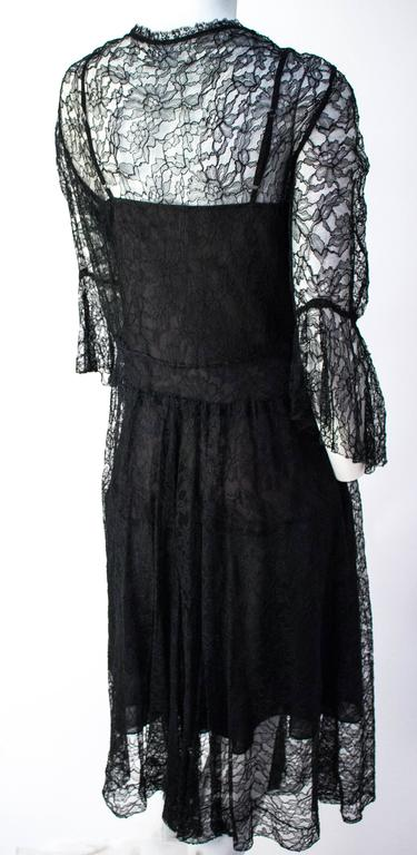 70s Black Lace Dress and Slip. No closures.
