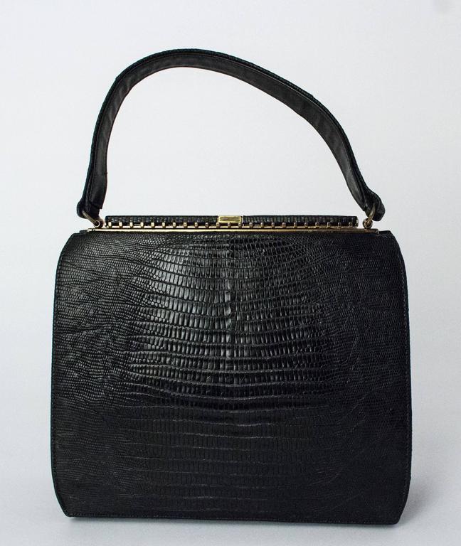 50s Roos Atkins Black Lizard Handbag. Comes with original mirror (slight tarnish), coin purse, and comb. Leather interior.