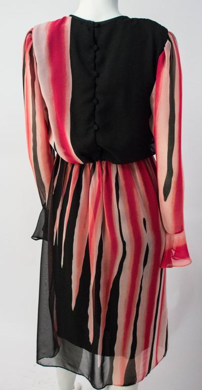 80s Hanae Mori Printed Silk Chiffon Magenta and Black Dress. Lined bodice and skirt. Back button closure. Elasticated waist, 26