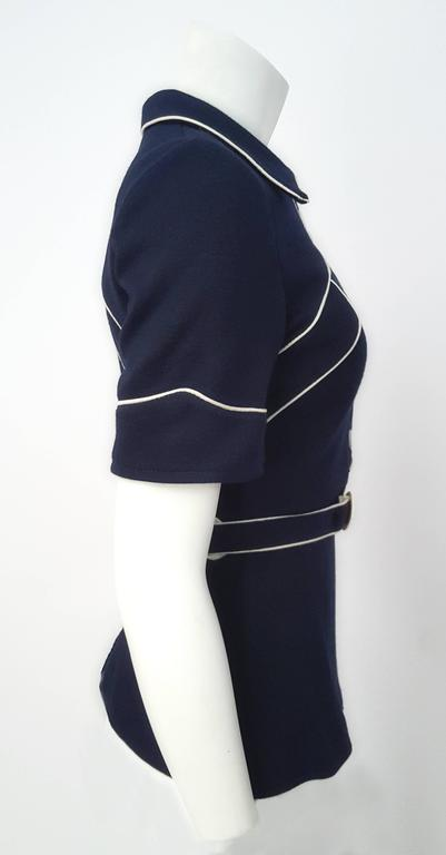 60s Navy Blue Knit Top w/ White Piping. Front button closure. Original belt. Slight fading at lining shown in photo.