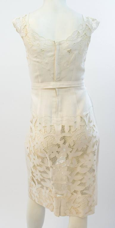 50s White Linen and Lace Dress. Lace is hand done Irish crochet and cutwork. Original belt. One panel of lace lining in front bodice, the rest of the dress is unlined. Back metal zipper closure.