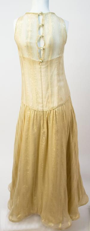 70s Gold Disco Lamé Dress. Sheer metallic striped chiffon over a champagne silk charmeuse lining. Horsehair hem. Back zip and decorative button closure.