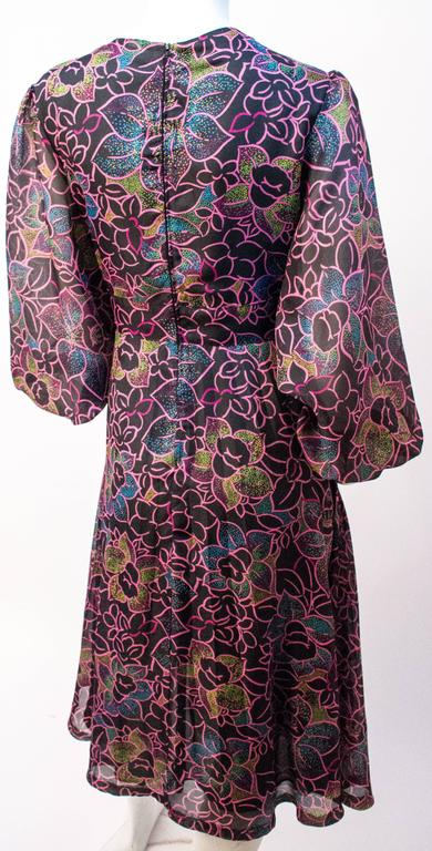 70s Floral Printed Chiffon Dress. Lined in synthetic black mesh. Back zip closure.