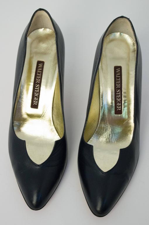 80s Walter Steiger Black Pumps. Handmade in Italy. Marked 8B. Some wrinkles visible on front vamp.