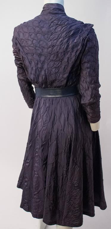 50s Aubergine Smocked Dress. Front button and metal side zip closures. Belt included, unoriginal.