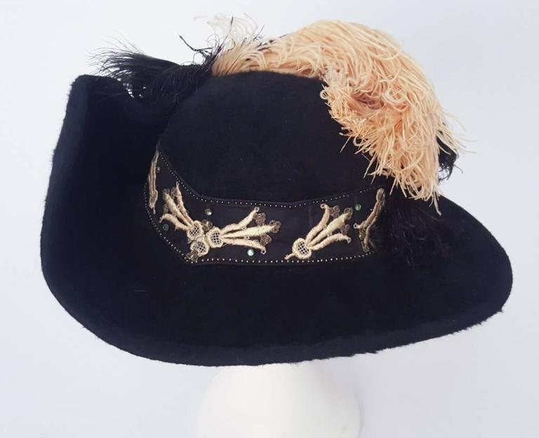 Authentic Edwardian black felt picture hat, trimmed in black and pink ostrich feathers and embroidered ribbon.