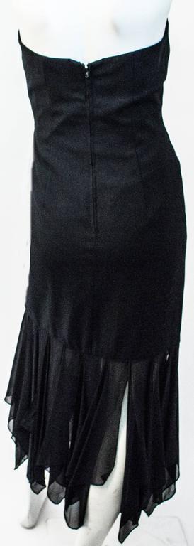 80s I Magnin Black Strapless Dress with Handkerchief Chiffon Hem.