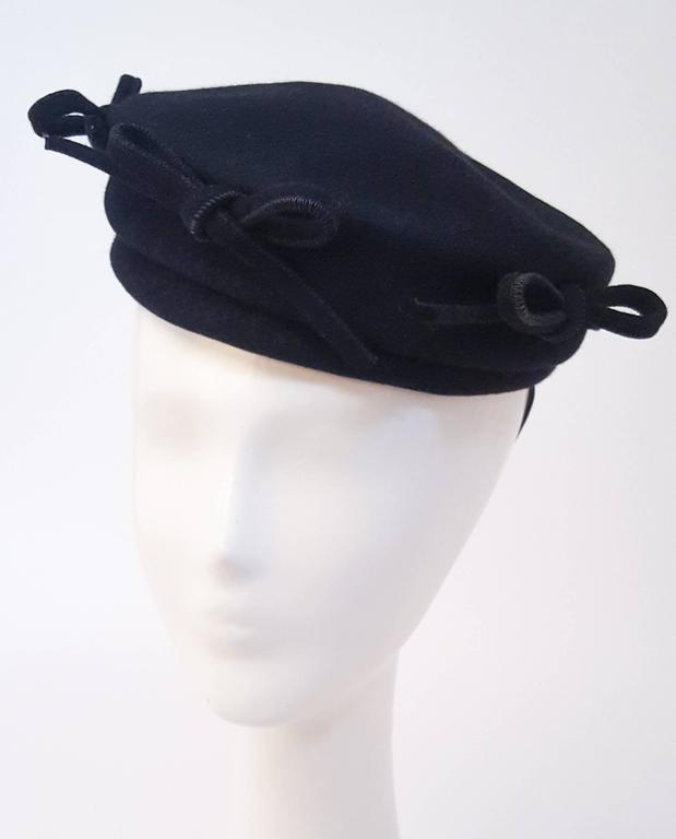 1940s Navy Fashion Hat w/ Bows. Held in place with elastic.