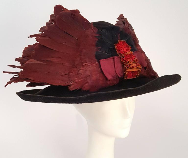 Edwardian Winged Picture Hat. Fully feathered 1910s wide brimmed picture hat with ruffle band detail. Adjustable inner hat band.