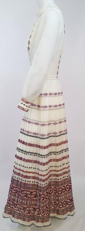 70s Shaheen Print White Maxi Dress. Interesting keyhole neckline. Sheer sleeves. Back zip closure.