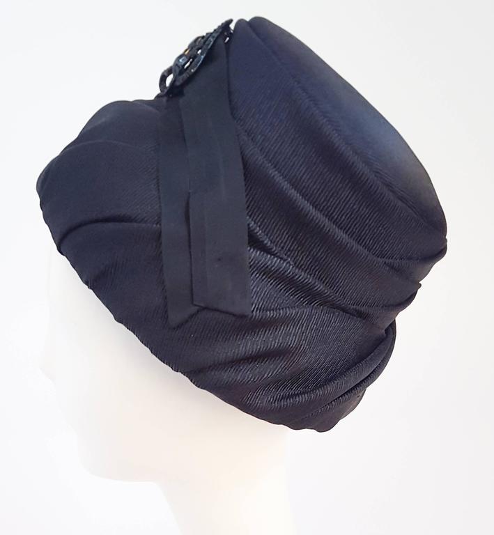 60s Mod Black Ruched Bucket Hat. Black rhinestone pin front detail.