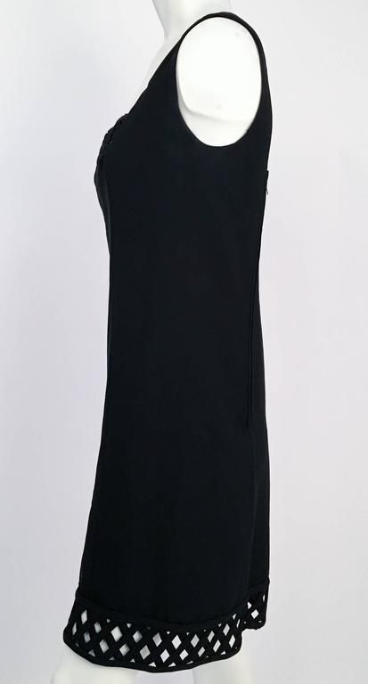 60s Gino Charles Black Crepe Lattice Detail Shift Dress. Woven lattice trim on both neckline and hem. Back zip closure. Fully lined.