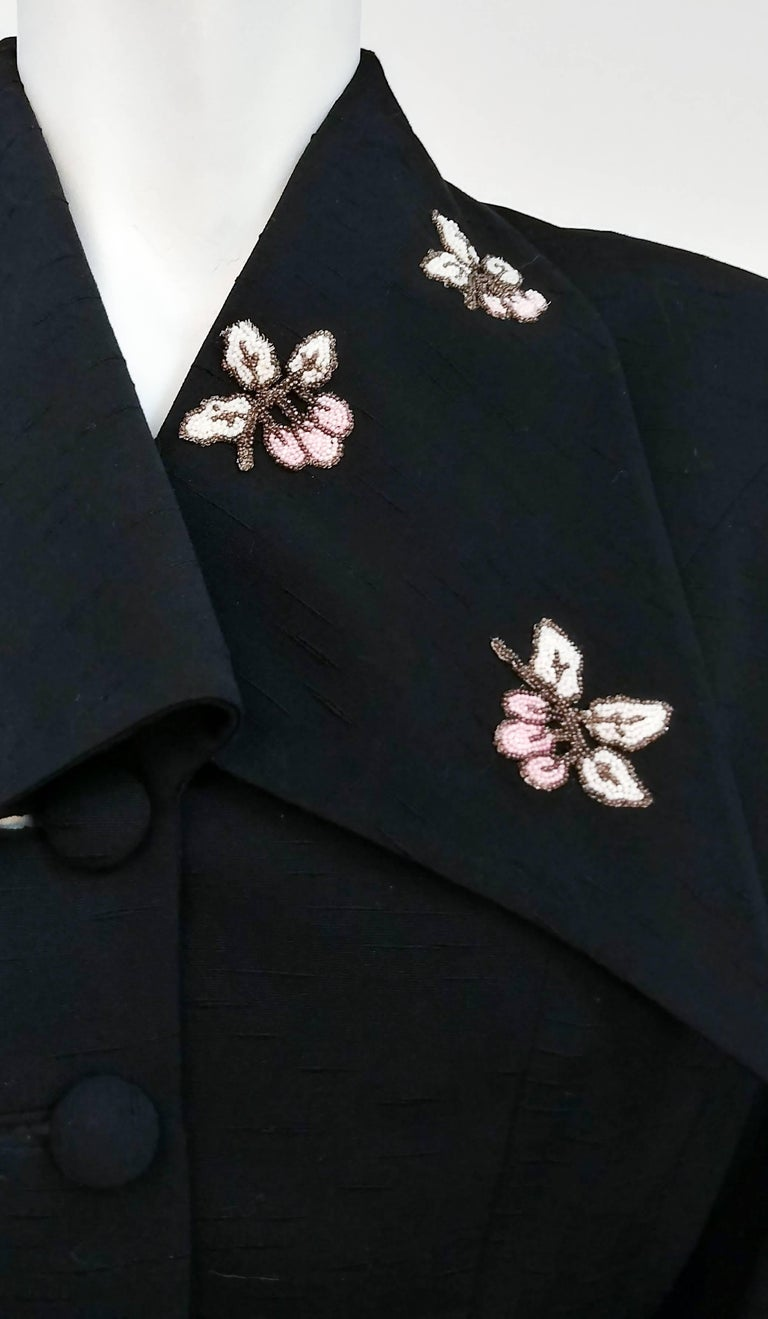 40s Lilli Ann Jacket w/ Beading Detail. Large pointed collar on which several leaf motifs are beaded. Button up front with matching covered buttons. Flounced sleeve detail. Extreme hourglass shape makes for striking silhouette. Slubby fabric makes