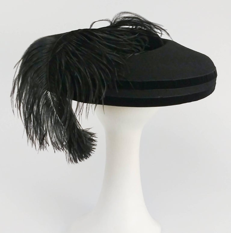 1980s Black Wool Wide Brimmed Hat w/ Feather In Excellent Condition For Sale In San Francisco, CA