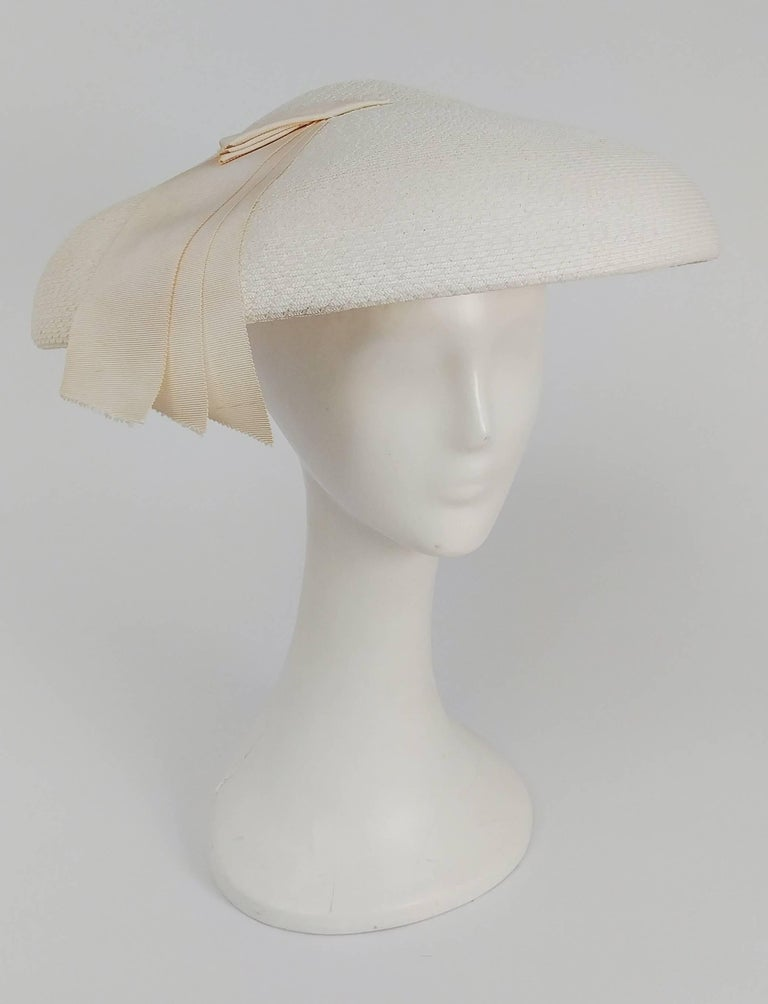 1950s New Look White Saucer Hat. Grosgrain ribbon embellishments.