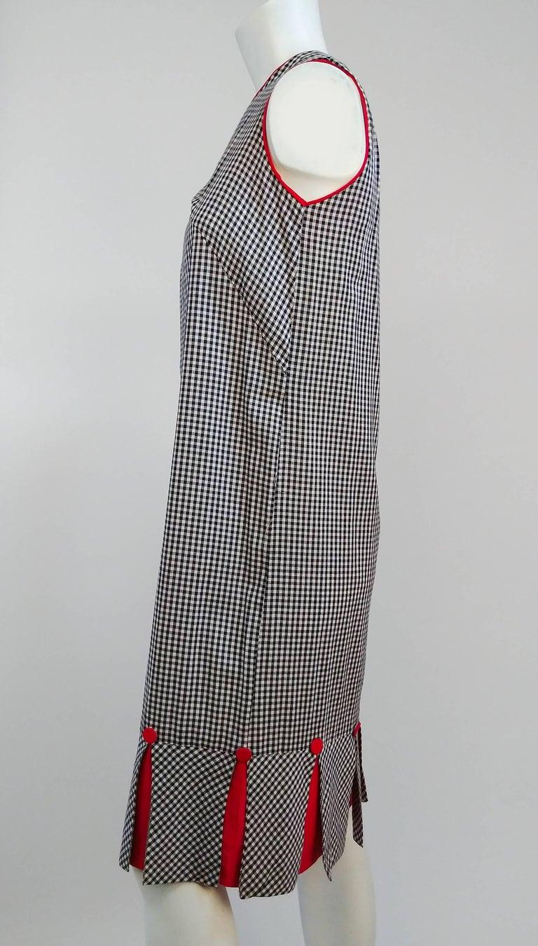 1960s Black & White Gingham Drop Waist Dress. Faux pleated hem w/ red button detail.