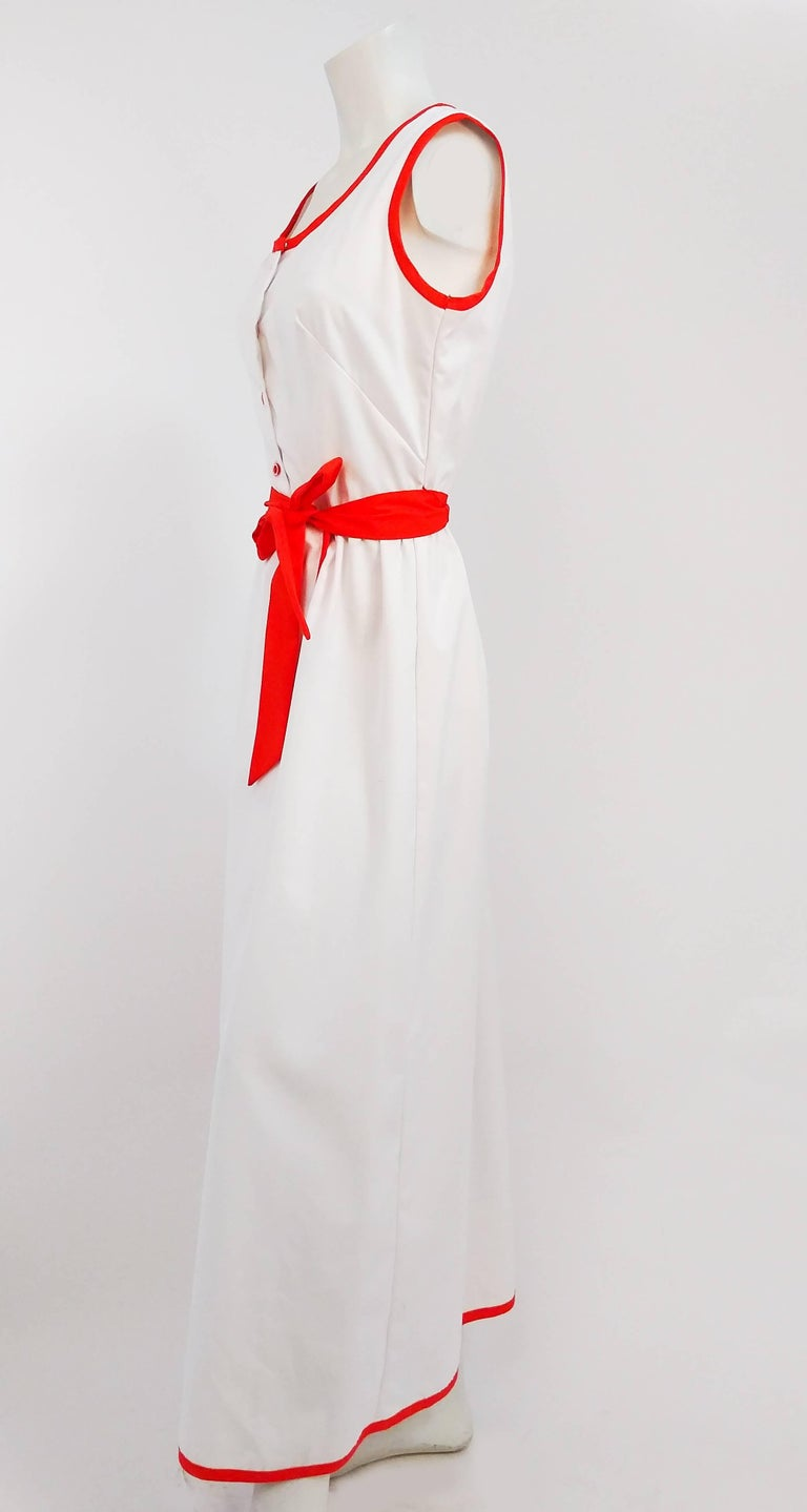 1970s Cotton Watermelon Wrap Maxi Dress. Red trim along collar and hem make this summer sundress pop. Large watermelon applique makes for fun, whimsical detail to brighten your day. Comes with matching red sash, original. Fastens with snaps at side