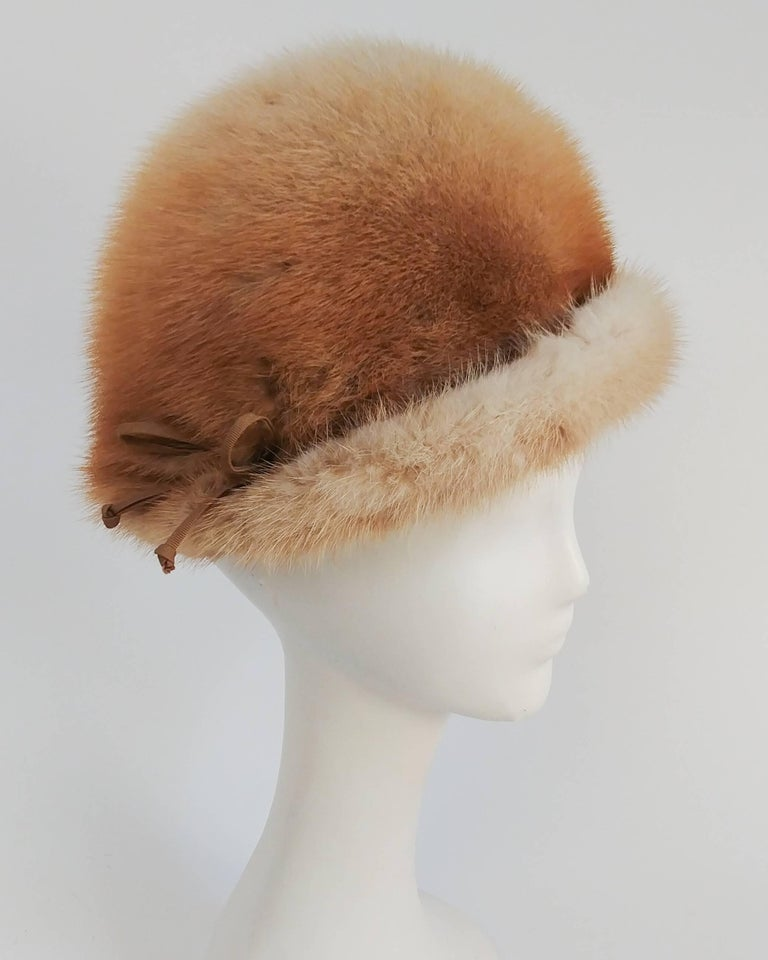 1960s Blonde Mink Cloche Hat. Decorative ribbon embellishes the brim.