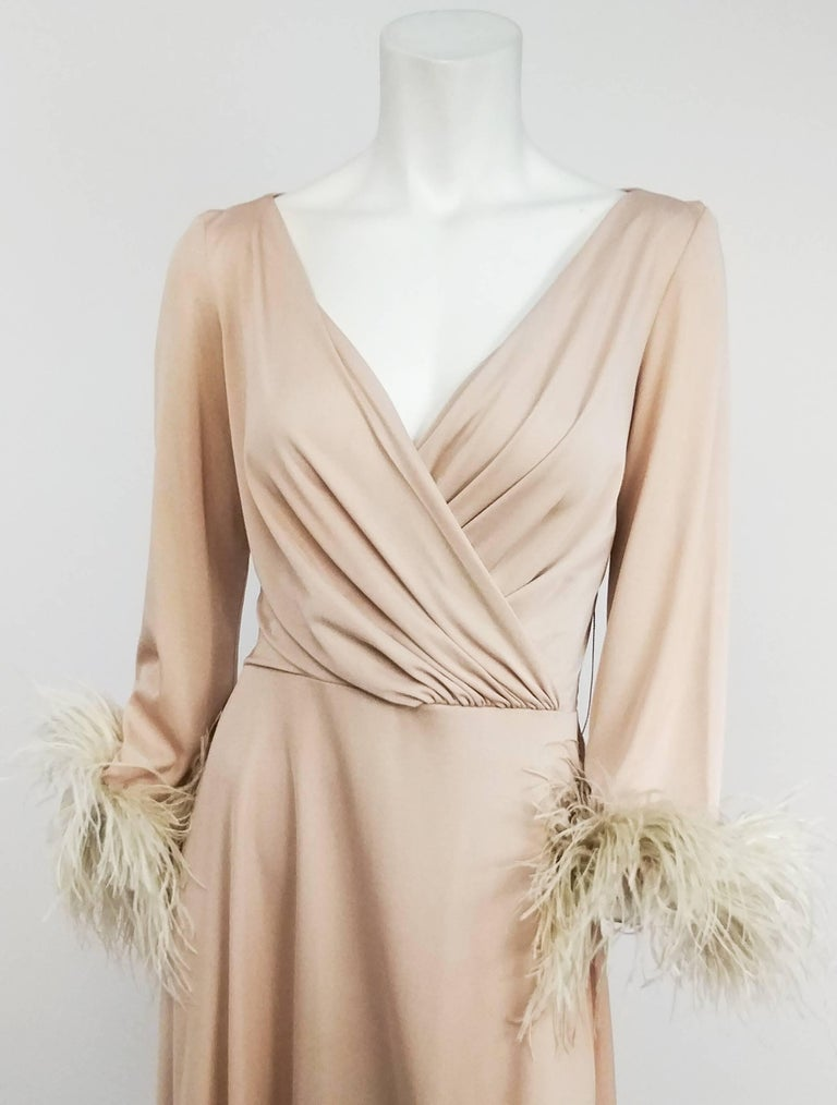 1970s Lilli Diamond Nude Dress with Feather Trim. Stretch jersey nude dress with draped bodice and feather trimmed sleeves. Zips up back.