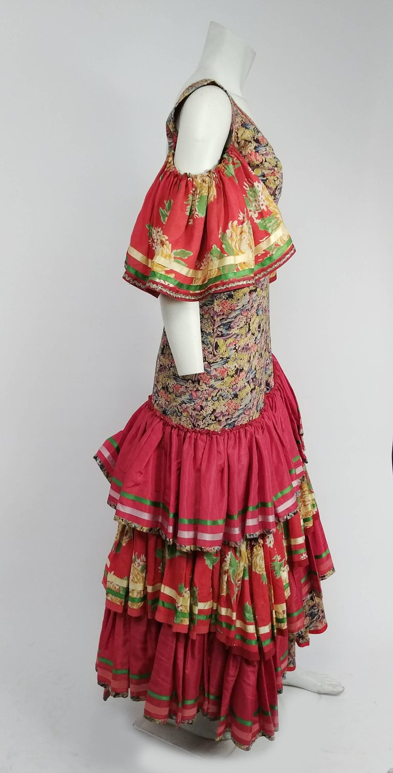 1950s Colorful Printed Flamenco Dress. Trimmed with satin ribbon and metallic lace. Bare shoulders, large ruffled sleeves. Multi-tiered ruffled skirt in contrasting fabrics.