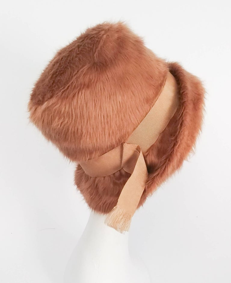 1970s Mr. John Faux Fur Bucket Hat. Grosgrain ribbon band, folded multiple times with purposefully frayed ends at side.