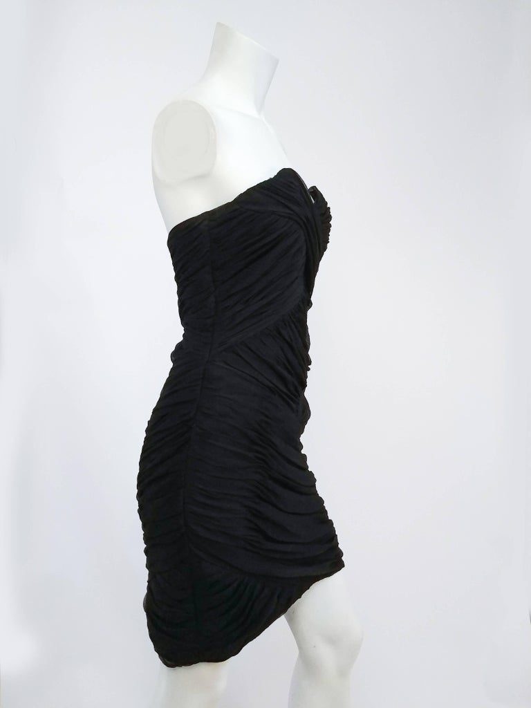 David Fielden Black Strapless Silk Chiffon Dress. Sweetheart neckline with boned cups. Draped chiffon in crossover pattern. Lined in silk.