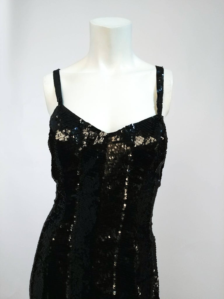 1990s Ralph Lauren Black Sequin Gown. Purple label. Plunging low back with crossed straps. All-over sequins with a slight striped pattern.