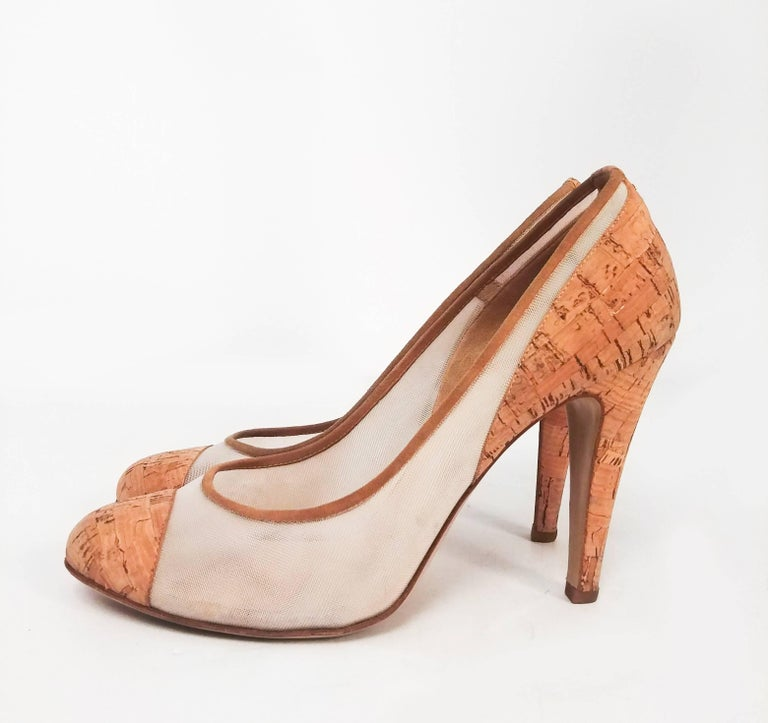 Chanel Cork Two Tone Pumps. Cork toe cap and heels and mesh uppers are an elegant twist on the classic Chanel two-tone shoe. Stiletto heel, double C logo at back. Barely worn.