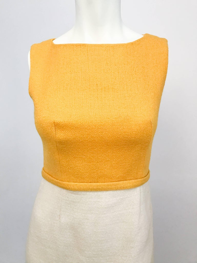 1960s Lanz Mod Daisy Dress. Mod yellow and beige tweed sleeveless dress with daisy embroidery along the hem.